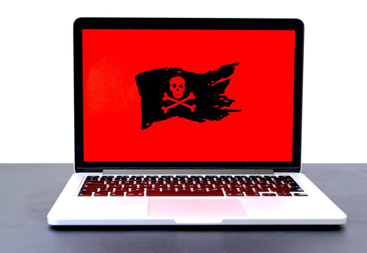 Hacked website with a red screen flying the Jolly Roger