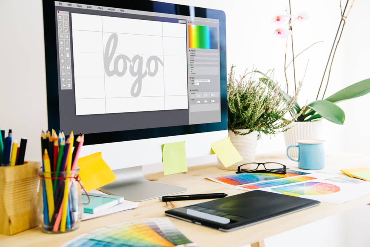 Responsive logo design on an iMac computer